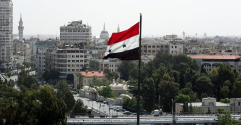 A Syrian flag flutters in Damascus, Syria April 20, 2018. REUTERS/Ali Hashisho